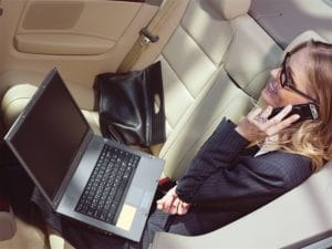 Business woman using Lincoln Town Car